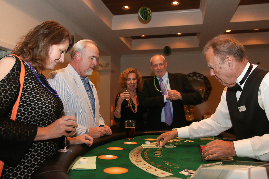 Kelli and Scott Robertson play casino games with Judy Hicks and Eric Hespenheide. Photo by Paige Wilson
