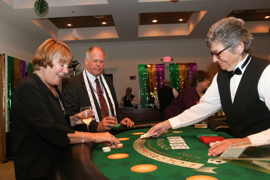 Kim Lhota reacts to beating the dealer at blackjack. Photo by Paige Wilson