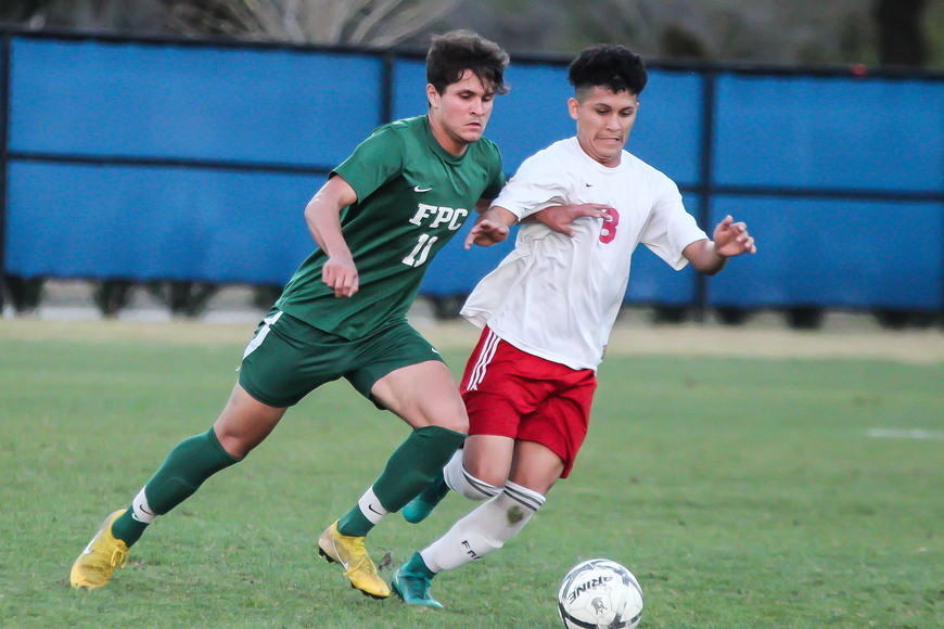 FPC's Nick De'Morias attempts to steal the ball away from an opposing player. Photo by Ray Boone