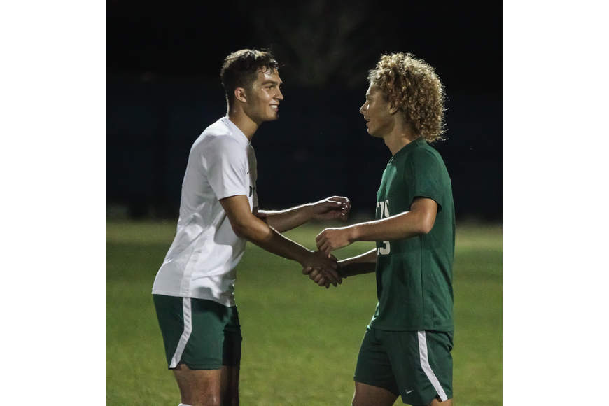 FPC's Baron Pedro and Chrystian Orren shake hands after competing against each other. Photo by Ray Boone