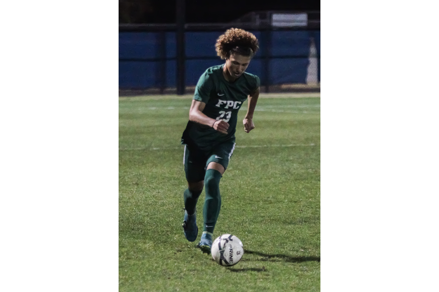 FPC's Chrystian Orren dribbles the ball down the field. Photo by Ray Boone
