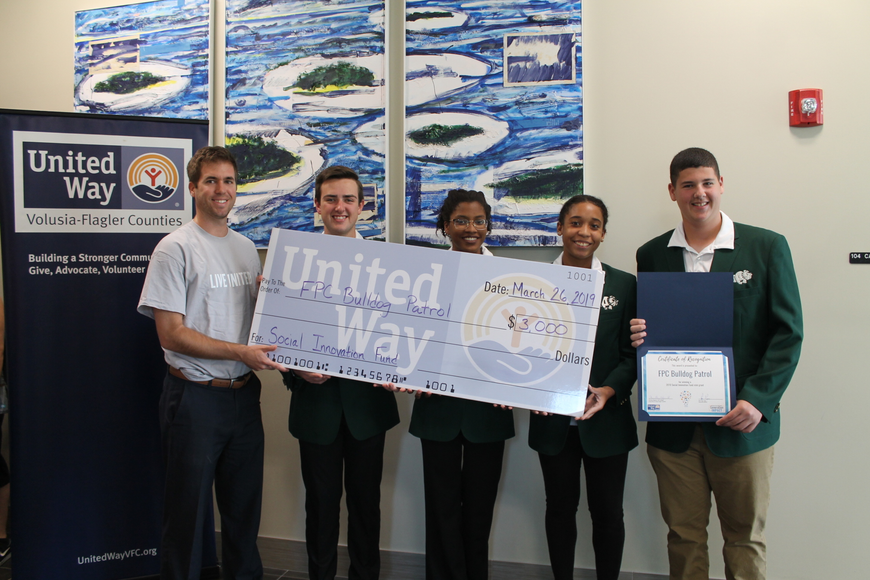 Generation IMPACT Chair Ryan Page with FPC Bulldog Patrol members Will Patin, Gabby Jackson, Sydni Leon and Nick Blumengarten. Photo courtesy of United Way
