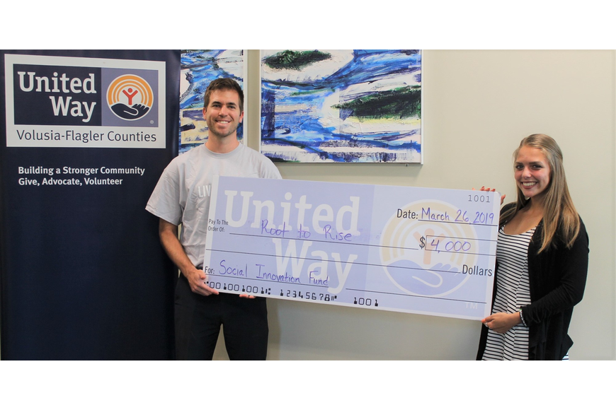 Generation IMPACT Chair Ryan Page with Root to Rise creator Ekatereena Kouzina. Photo courtesy of United Way