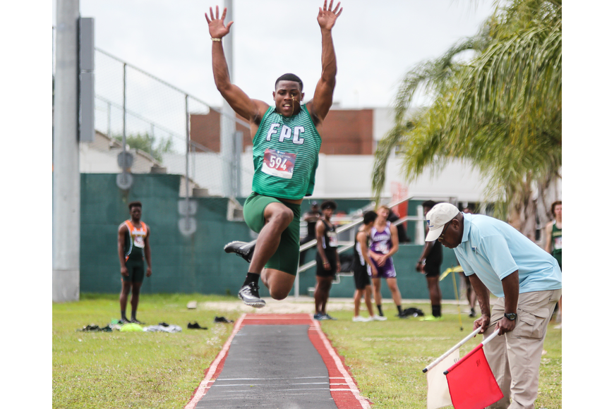 FPC's Ty Jenkins takes a leap in the long jump at districts. Photo by Ray Boone