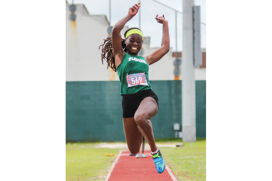 The Bulldogs' Prosperity Wright does the long jump at the district meet. Photo by Ray Boone