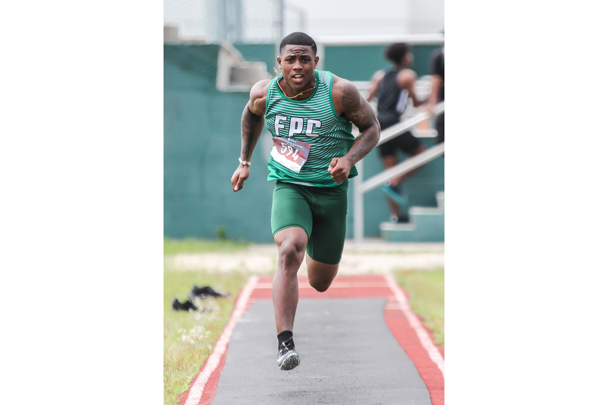 FPC's Ty Jenkins runs down the track for the long jump at districts. Photo by Ray Boone