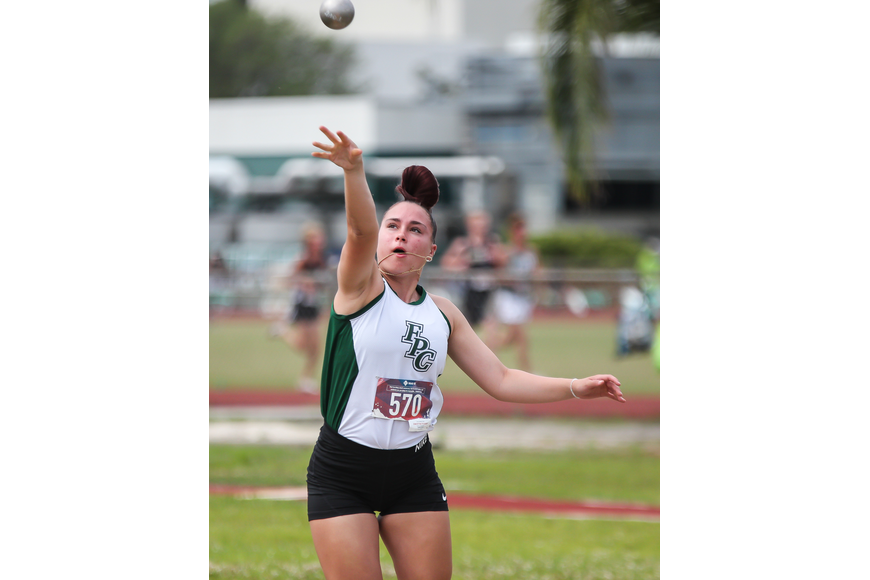 FPC's Anisa Zwolinski does the shot put at the district meet. Photo by Ray Boone