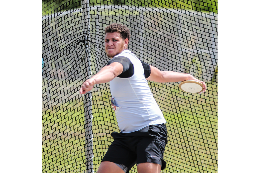 The Bulldogs' Verneal Henshaw winds up for the discus throw at the district meet. Photo by Ray Boone