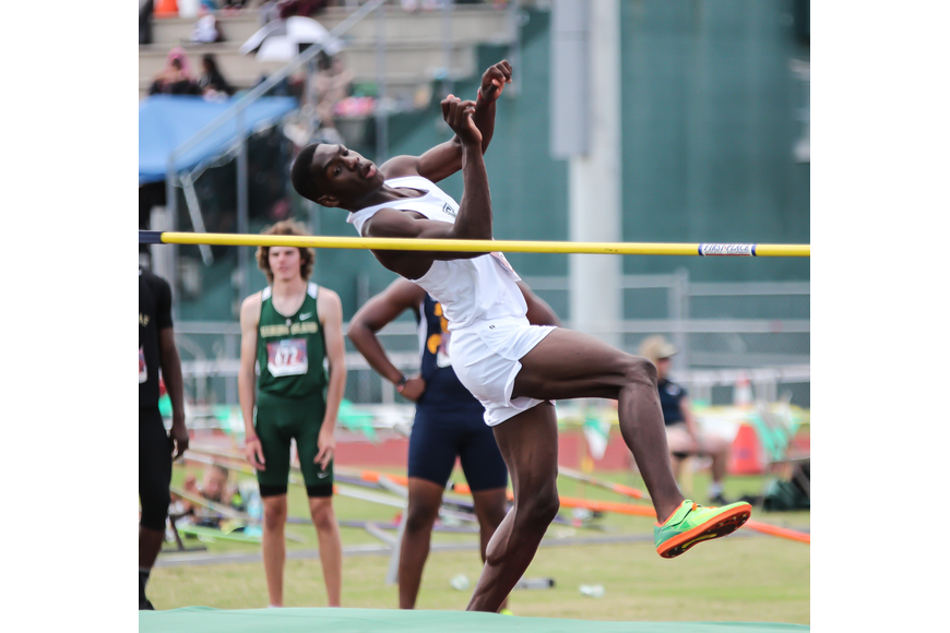 FPC's Marcus Freeman does the high jump at districts. Photo by Ray Boone
