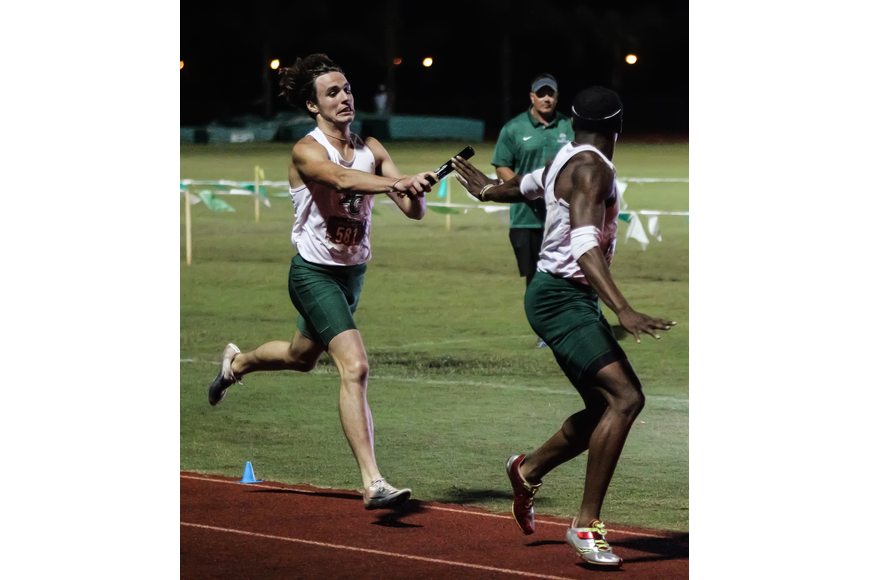 FPC's Nathan Farrell hands the baton off to teammate Ken'Deric Morton. Photo by Ray Boone