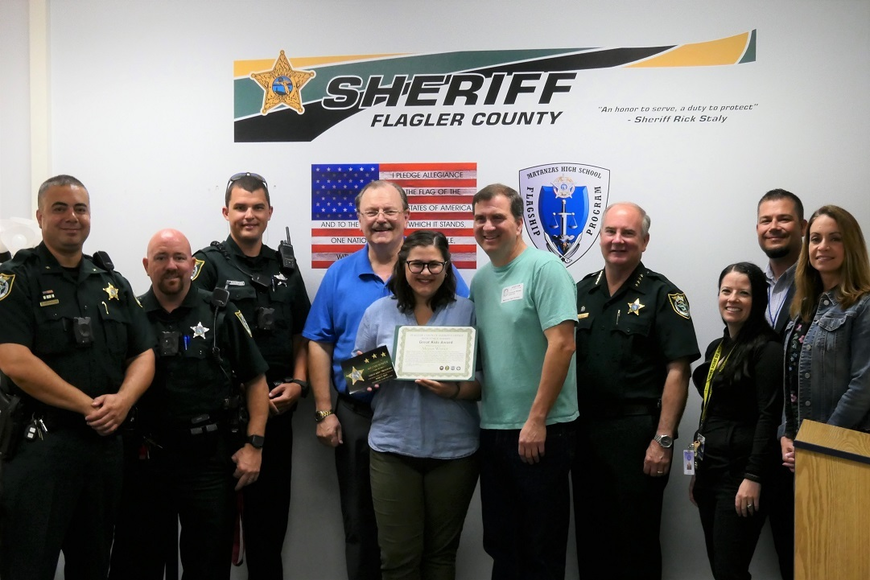 Cmdr. Reynolds, SRDs Landi and Champion, student Megan Winter with her grandfather and father beside her, Sheriff Rick Staly, Ms. Bartow, Mr. Ossler and Assistant Principal Castanheira. Photo courtesy of FCSO