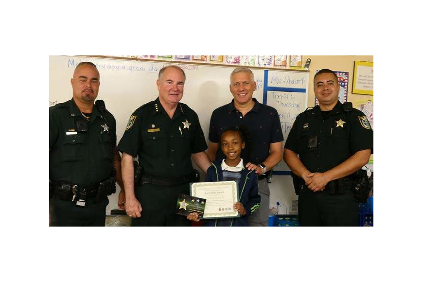 SRD Lilavois, Sheriff Staly, L'Aaliyah, Assistant Principal Menard and Cmdr. Reynolds. Photo courtesy of FCSO