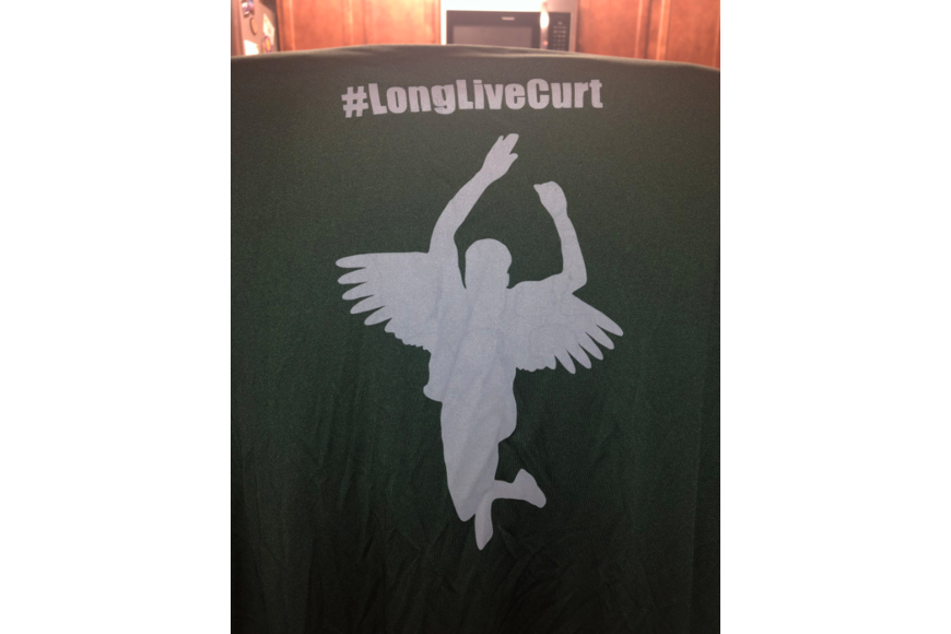 A silhouette of Curtis Gray jumping with angel wings and a halo. The shirt costs $20, and the profits will go to a scholarship in Gray's honor. Courtesy photo