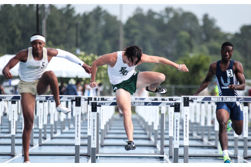 The Bulldogs' Nathan Farrell leaps over a hurdle during the prelim for the 110-meter hurdles at the FHSAA track and field state championships. Photo by Ray Boone