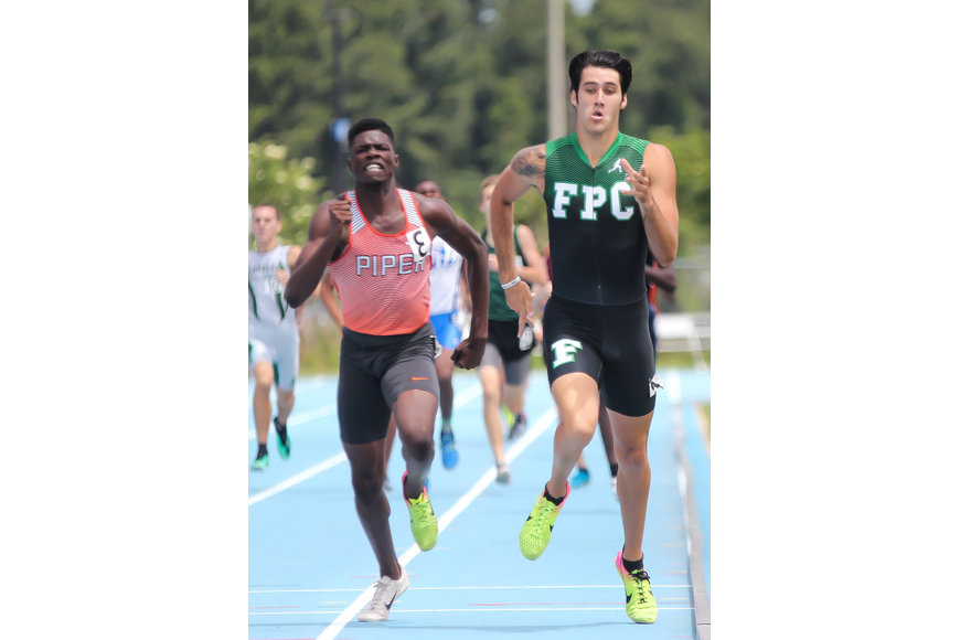 FPC's Jacob Miley goes head-to-head with Piper's Sukeil Foucha in the 800-meter run at the FHSAA track and field state championships. Miley finished .03 seconds behind Foucha. Photo by Ray Boone