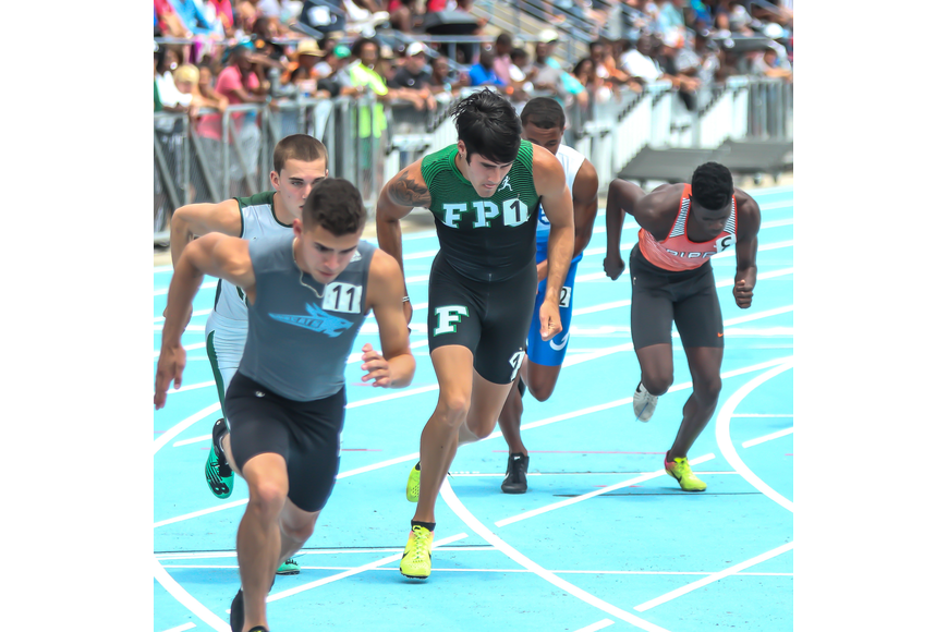 The Bulldogs' Jacob Miley bursts down the track at the start of the 800-meter run at the FHSAA track and field state championships. Photo by Ray Boone
