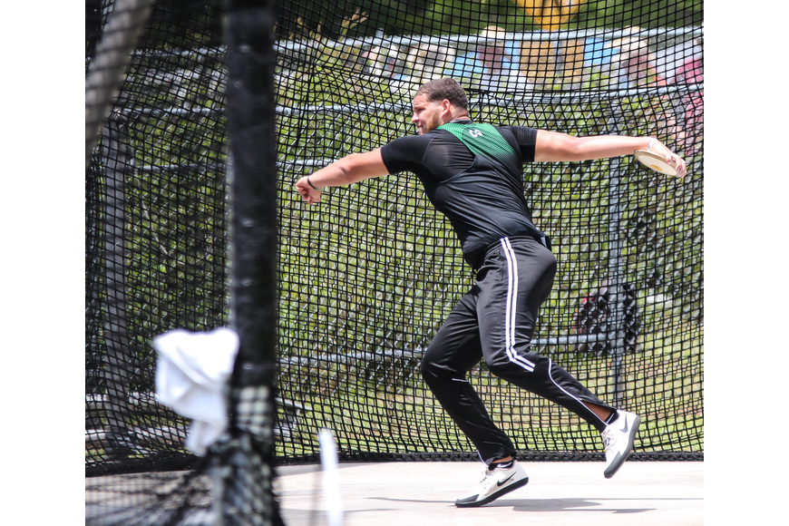 FPC's Verneal Henshaw throws the discus during the FHSAA track and field championships. Photo by Ray Boone