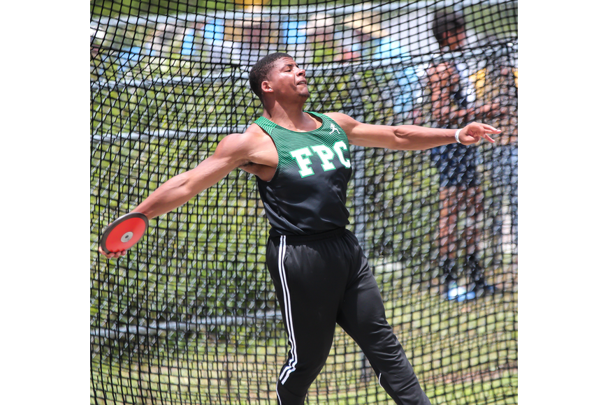 FPC's Deshaun Hugee throws the discus during the FHSAA track and field championships. Photo by Ray Boone