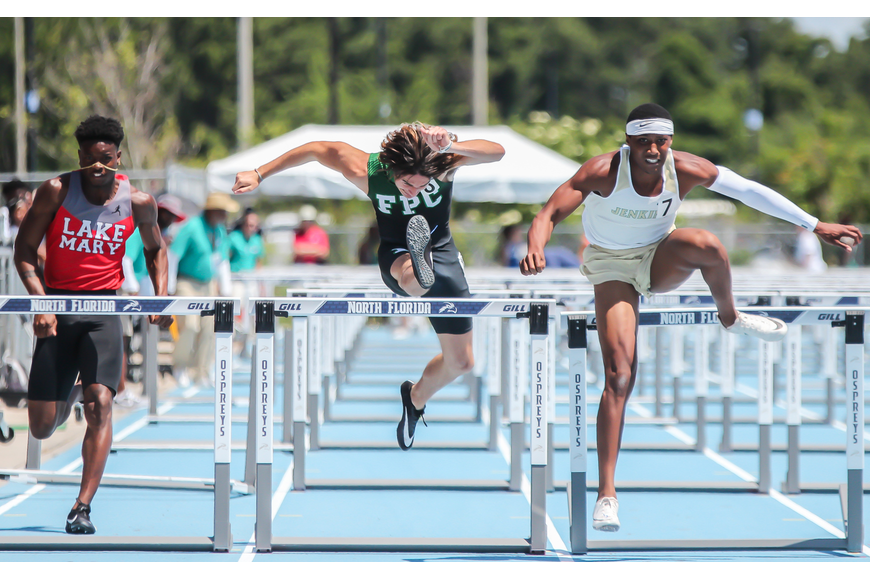 The Bulldogs' Nathan Farrell leaps over the final hurdle in the 110-meter hurdles at the FHSAA track and field championships. Photo by Ray Boone