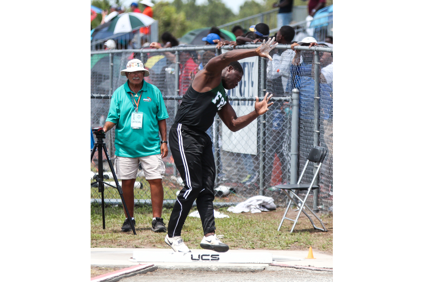 FPC's Nelson Paul throws the shot put in the FHSAA track and field state championships. He finished second. Photo by Ray Boone