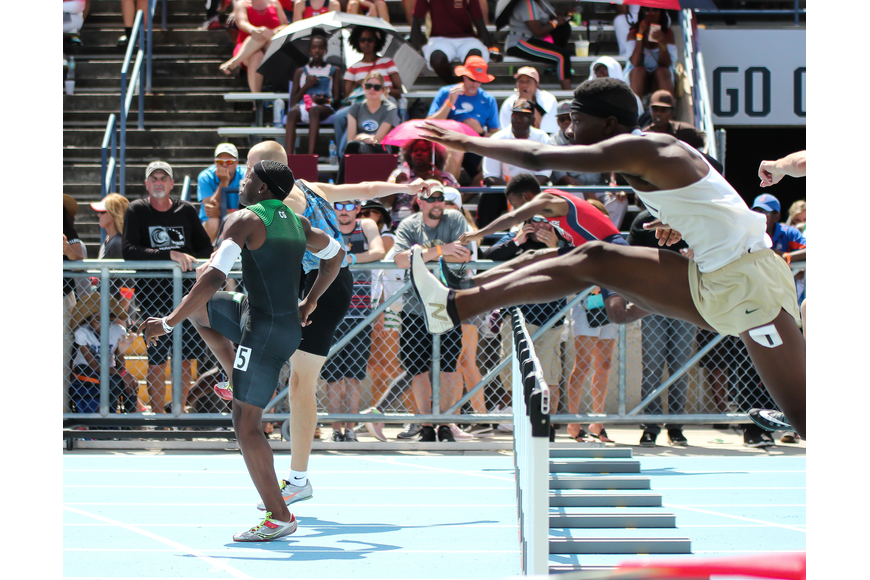 The Bulldogs' Ken'Derick Morton sprints toward the finish line after leaping over the final hurdle in the 300-meter hurdles of the FHSAA track and field state championships. Photo by Ray Boone