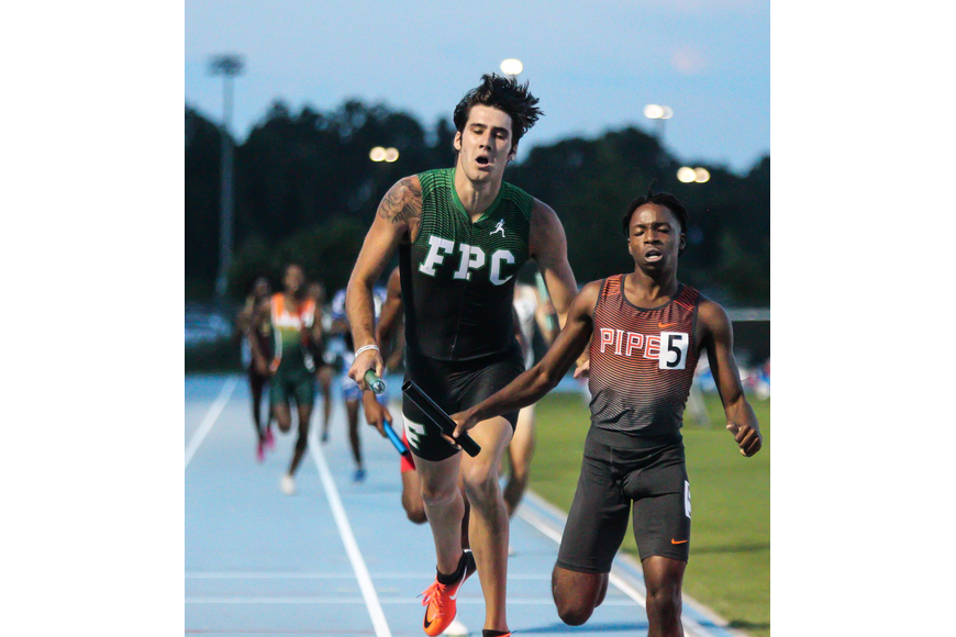 FPC's Jacob Miley crosses the finish line in the 4x400-meter relay at the FHSAA track and field state championships. Photo by Ray Boone