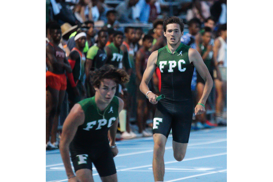 FPC's Darrell Thomas prepares to hand the baton to teammate Nathan Farrell in the 4x400-meter relay at the FHSAA track and field state championships. Photo by Ray Boone