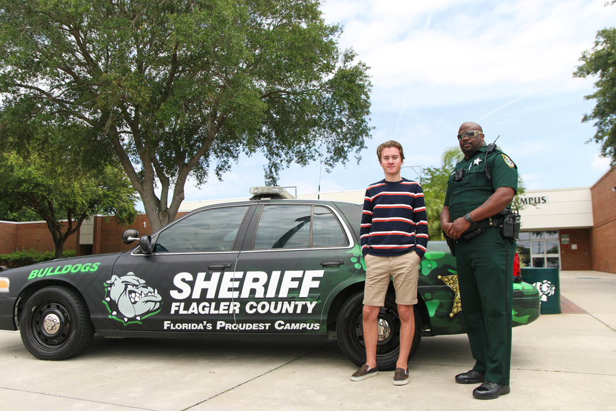 FPC sophomore Evan Tomczak and one of the FPC SRDs Jason Williams stand by the SRD car that Tomczak designed. Photo by Paige Wilson