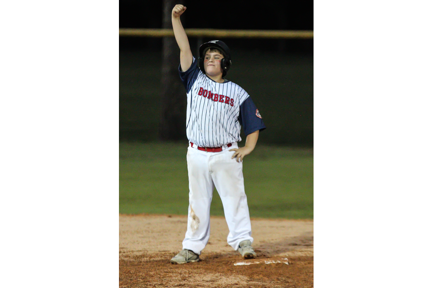 The Bombers' Colin Craig celebrates after hitting an RBI double. Photo by Ray Boone