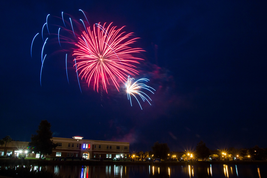 Fireworks light up the sky over Central Park in Town Center. Photo by Paige Wilson