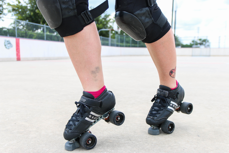 Alyssa Roscoe's legs have bruises — and a tattoo that represents her love for roller derby. Photo by Paige Wilson