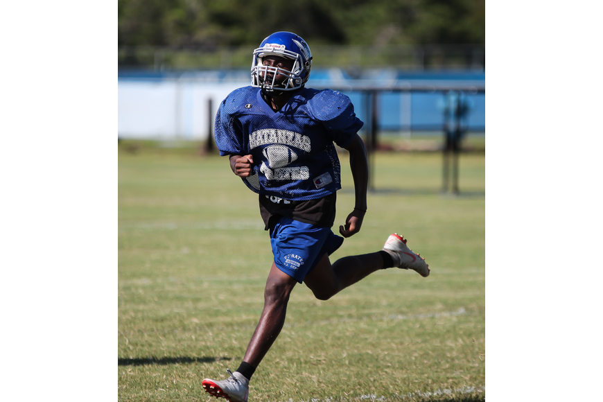 Matanzas' Noah Cundiff runs gassers during practice. Photo by Ray Boone