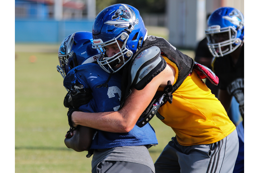 Matanzas' Rex Robich tackles an opposing player during practice. Photo by Ray Boone