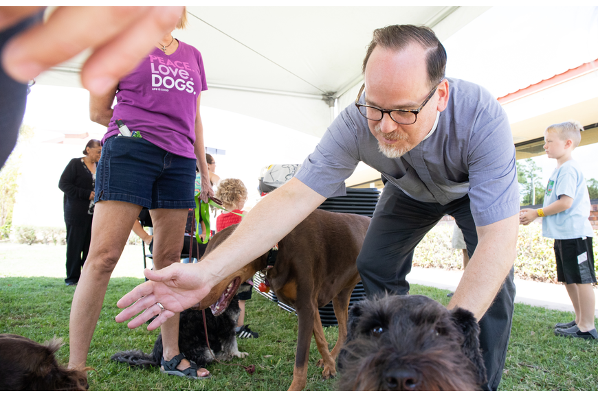 Rev. Bob Goolsby during a pet blessing session.  Photo by Paola Rodriguez