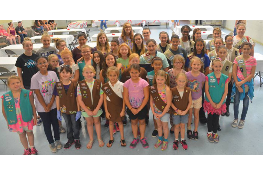 : Dozens of Girl Scouts from St. Johns and Flagler counties worked together to help farmworkers in Hastings. The troops made and served dinner and helped give the workers a day of relaxation and fun. Courtesy photo