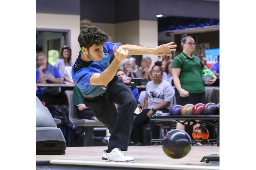 Matanzas' Sam Torres bowls against FPC. Photo by Ray Boone