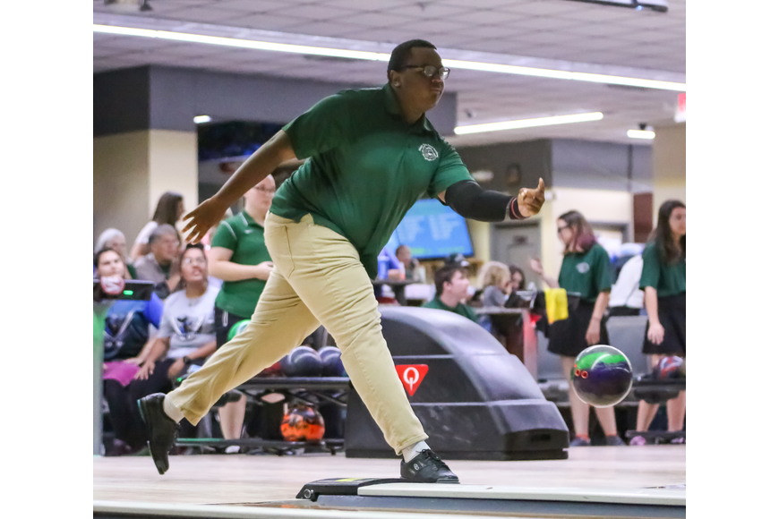 FPC's Trevor Brickhouse bowls against Matanzas. Photo by Ray Boone