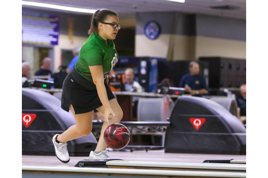 FPC's Maddie Oliva bowls against Matanzas. Photo by Ray Boone