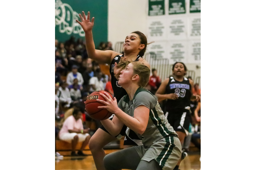 FPC's Lily Dunaway shoots a layup against the Pirates. Photo by Ray Boone