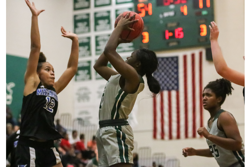 FPC's Nariya Perry pulls up for a jump shot. Photo by Ray Boone