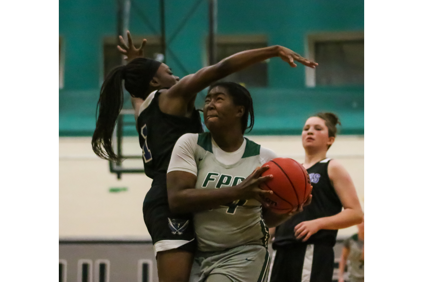 FPC's Ga'briel Locke drives in for a layup. Photo by Ray Boone