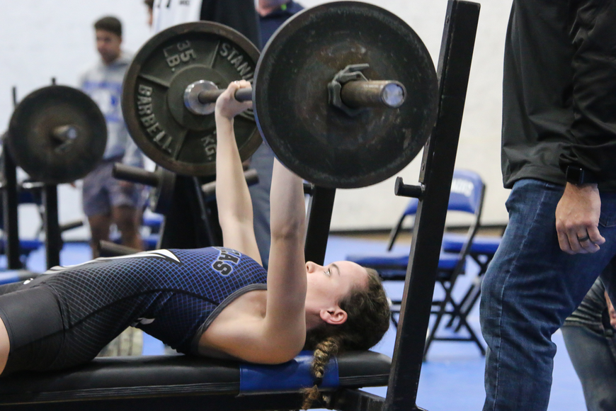 Matanzas' Andie Tice does the bench press. Photo by Ray Boone