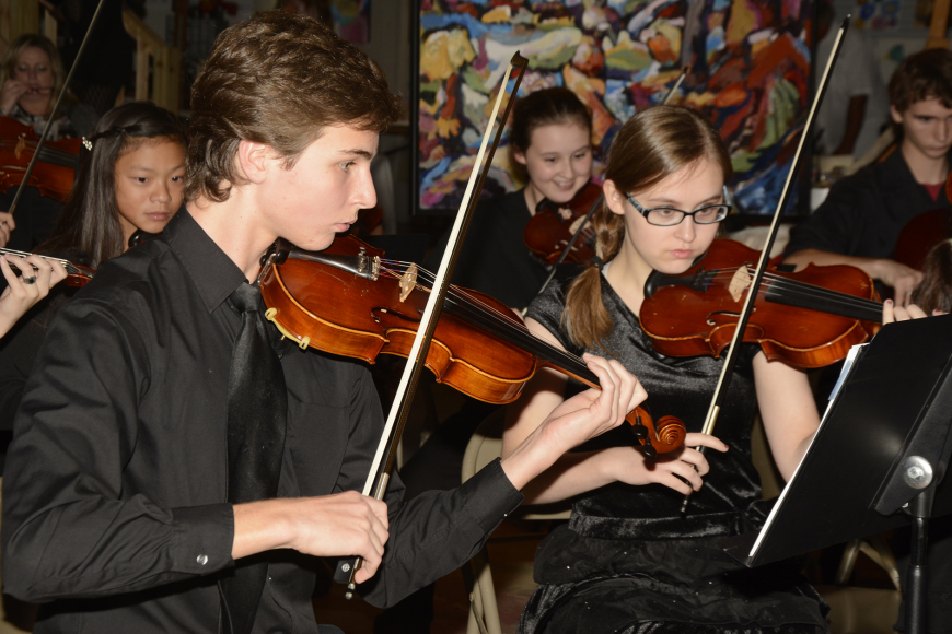 Flagler Youth Orchestra members, Logan Smith and Brooklynn Hoffman, performed at the Salvo Art Project Friday, Dec. 4.