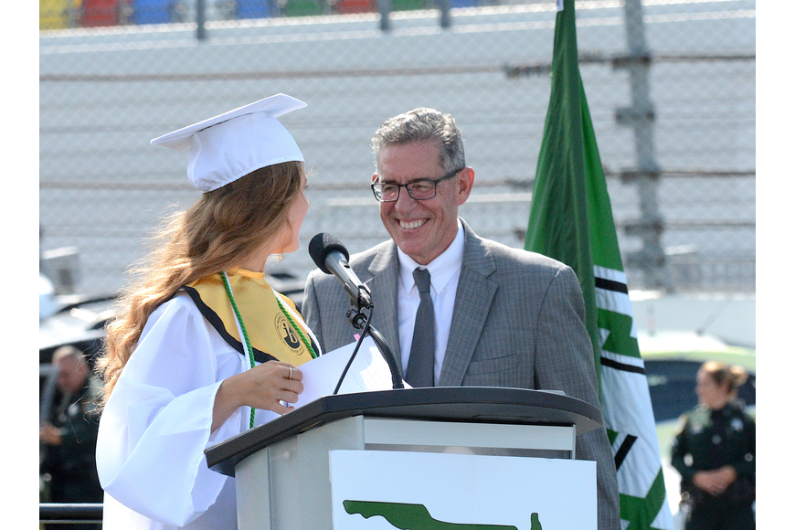Alyssa Santore introduces Principal James Russell. Photo by Brian McMillan