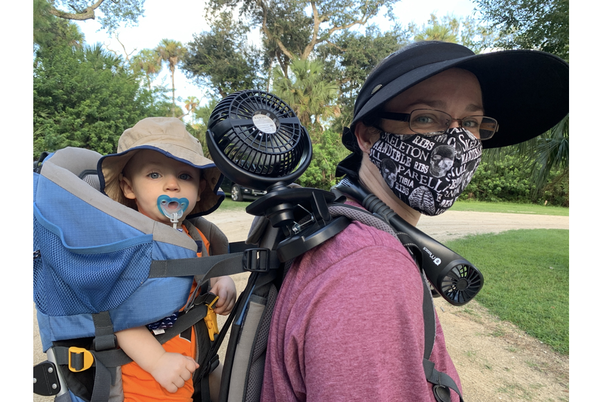 Jaci Phillips and her son, Vincent, equipped themselves with battery-powered fans for the cleanup. Photos by Brian McMillan