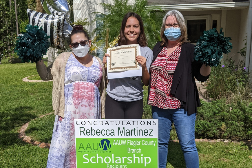 Haydee Bernal (white mask) and Terri Smith (blue mask), AAUW Flagler Scholarship Committee members, with Rebecca Martinez, FPCHS senior, and scholarship recipient. Courtesy photo