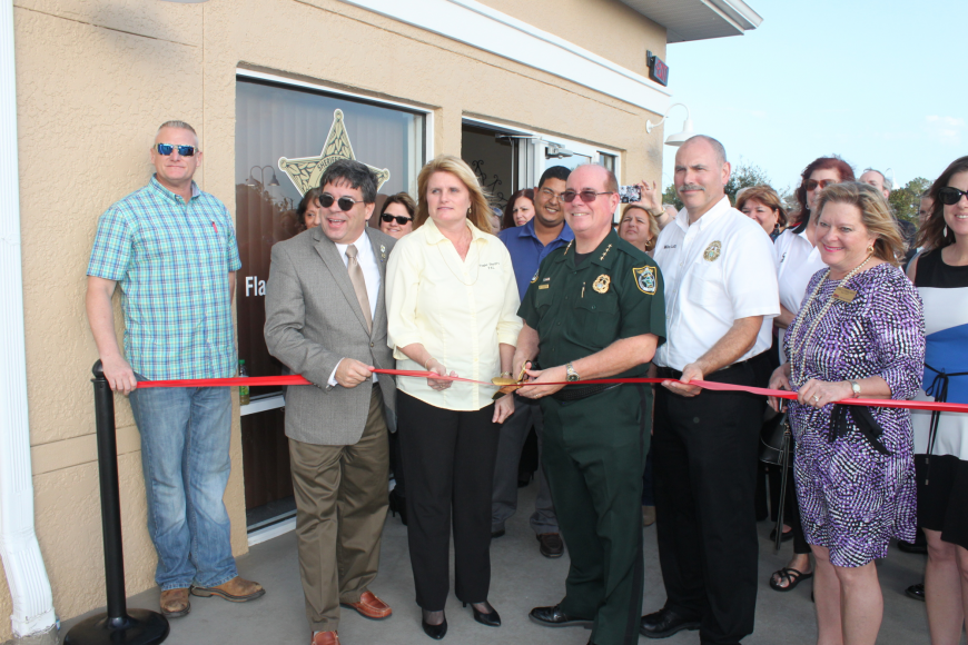 Deputy Scott Jackson; Flagler County Commissioner Nate McLaughlin; Kim Hale, PAL director; Sheriff James L. Manfre; Sgt. Mike Lutz; Cornelia Manfre, the Sheriff's wife. (Photo courtesy of the Flagler County Sheriff's Office.)