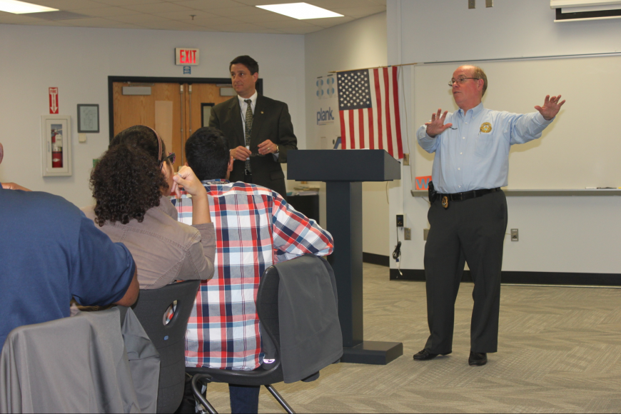 Sheriff James L. Manfre addresses students at Matanzas High Schoo. Sheriff's Office spokesman Director Jim Troiano is at left.(Photo courtesy of the Flagler County Sheriff's Office.)