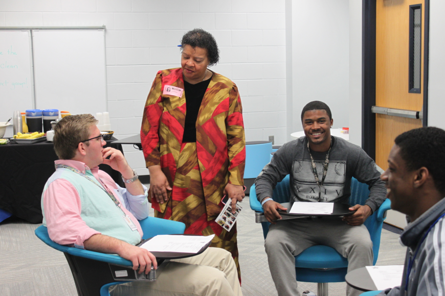 "Pastor Gwen Jackson speaks with students Andrew Wills, Douglas Wilson and Troy Buchanan at a  ""One Common Ground'' meeting at Matanzas High School. (Photo courtesy of the Flagler County Sheriff's Office.)"