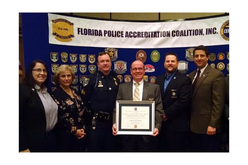 FLA-TAC President Juliane Day, Specialist Michele Bagnoli, Sgt. Adam Biss, Sheriff James Manfre, FLA-TAC Commissioner Nathan Lee, Director Jim Troiano and FLA-TAC Executive Director Bob Brongel. (Photo courtesy of the Flagler County Sheriff's Office.)
